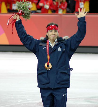 Apolo Ohno receiving his gold medal