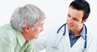 parkinson's patient speaking with his doctor