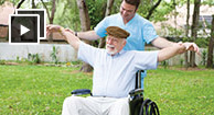 senior man with arthritis with physical therapist