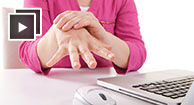 aching arthritis hand pain with laptop