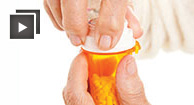 arthritic hands opening pill bottle