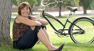 woman with osteoarthritis out with bike