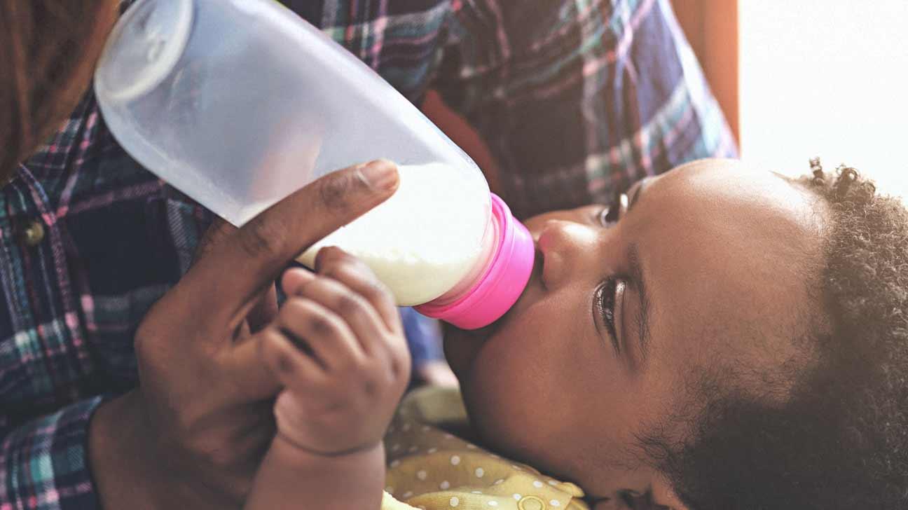 A parent feeding their kid