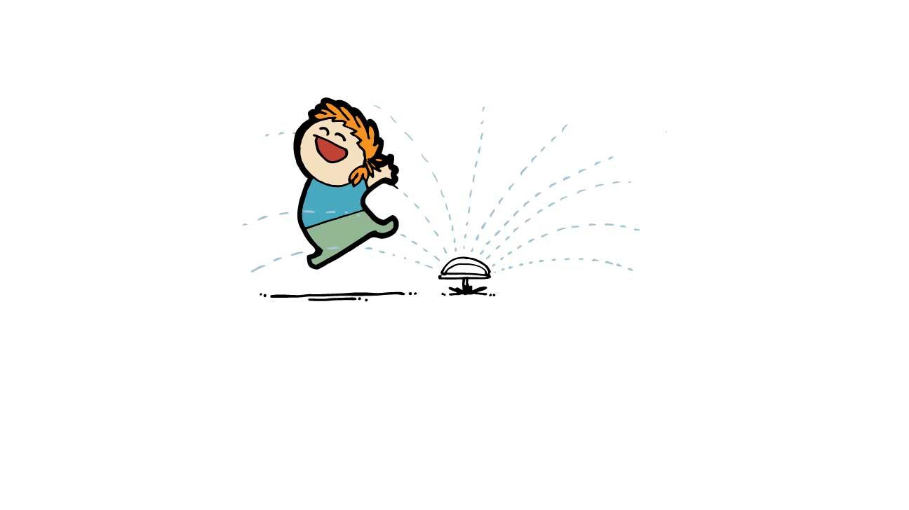 Woman running through sprinklers