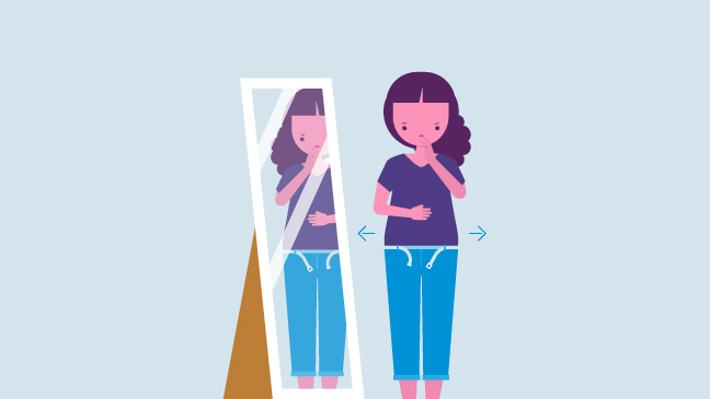 pregnant woman looking in the mirror
