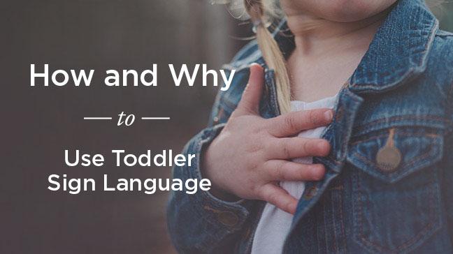 toddler doing sign language