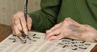 person with palindromic rheumatism doing a crossword