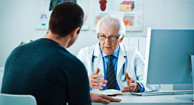 man speaking with his doctor about STDs