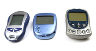 A few different types of glucose meters.