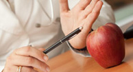 doctor pointing to an apple